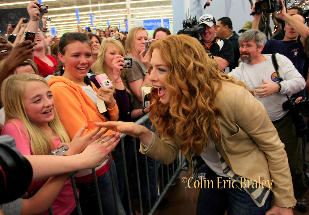 Fans and Twilight star Rachelle Lefevre who plays the character Victoria greets fans at the Walmart store in Riverton, Utah during the midnight DVD movie release event March 20 and 21st, 2009. (AP Photo/Colin Braley)