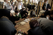 Christian pilgrims pray over the Stone of Anointment in Jerusalem's Old City, Saturday, April 3, 2010.