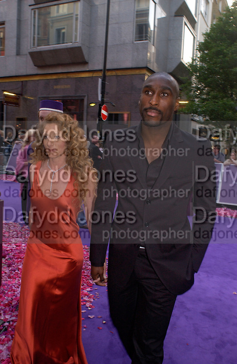 Kelly Hoppen and Sol Campbell, Asprey Store relaunch party after rebuilding. New Bond St. 18 May 2004. ONE TIME USE ONLY - DO NOT ARCHIVE  © Copyright Photograph by Dafydd Jones 66 Stockwell Park Rd. London SW9 0DA Tel 020 7733 0108 www.dafjones.com