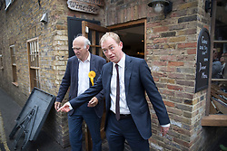 © Licensed to London News Pictures. 07/06/2017. Twickenham, UK. Liberal Democrat leader Tim Farron (R) emerges from a wine bar with local candidate Vince Cable as they campaign together in Twickenham on the last day of the election before the polls open. Photo credit: Peter Macdiarmid/LNP