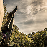 The bright sun casts a sharp shadow at the Theodore Roosevelt Memorial in Arlington, Virginia, just across the Potomac from the National Mall and Georgetown in Washington DC.