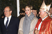 Well, she IS sparky: Princess Charlene honours Monaco's patron saint with Prince Albert by setting a fisherman's boat on fire in traditional ritual<br /> <br /> She marked her 38th birthday yesterday in characteristic low key style, and today Princess Charlene enjoyed celebrations of a different kinds as she fêted Monaco's patron saint.<br /> The royal stepped out with husband Prince Albert, 57, for the traditional remembrance service for St. Devote.<br /> St Devote's Day is a national holiday in Monaco in remembrance of their patron saint, a Christian martyr who was killed and tortured for her faith in the 4th century.<br /> <br /> The couple made their way through the crowds following a church service and stopped to shake hands with locals on their way.<br /> They also helped set light to a fishing boat - a tradition that's been going strong since the reign of Prince Louis II in 1942.<br /> <br /> According to legend, Christians saved St Devote's body and cast it off in a boat to Africa in the hope that once there she would receive a Christian burial.<br /> A dove then flew from her mouth and guided the boat to Monaco where it ran aground.<br /> <br /> The Saint is believed to have helped the principality in times of peril ever since.<br /> In line with the legend, Prince Albert and Princess Charlene took part in an annual ceremonial ritual remembering the Saint's final journey.<br /> They were given torches which they used to set fire to a fisherman's boat like the one that the Saint's body was carried on.<br /> Charlene looked elegant in a neutral colour palette for the occasion, teaming her nude coloured coat with voluminous sleeves with a pair of matching tawny suede knee boots. <br /> It's not the first time the Princess has chosen the footwear to complement her outfit for an important occasion. <br /> She previously sported the boots at the official presentation of her twins Prince Jacques and Princess Gabriella last January.   <br /> Charlene showed only a hint of her slim legs in a grey wool dress, which she matched with a large scarf in an indentical colour, a