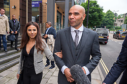 © Licensed to London News Pictures. 30/05/2018. Bristol, UK. GOLDIE (whose real name is Clifford Joseph Price) and his daughter CHANCE PRICE, leave Bristol Magistrates Court where Goldie has been fined for assaulting security guard at Glastonbury festival in 2017. Chance Price age 20, will also appear before the court. The court previously heard the case against Miss Price would be dropped once her father had been sentenced. Goldie, a DJ and musician age 52, had previously pleaded guilty to the charge by video link from Thailand, having failed to appear before the court in March and was contacted on a video-calling app to confirm his guilty plea. He admitted assaulting bouncer Dennis Poole on June 23 2017 by beating him. The judge then told the musician, who was based in Thailand at the time, that he would have to appear in person at court to be sentenced. Photo credit: Simon Chapman/LNP