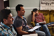 Hector Patal, centre, watches Arnoldo Silva and Palo Ruiz (far left) during an English class at the Agricultural Workers Alliance Support Centre in Leamington.
