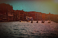 """""""Silhouette of Gondoliers against the late sun on the Grand Canal near the Church of Santa Maria del Giglio - Red""""…<br /> <br /> """"Venice"""" - Henry Wadsworth Longfellow: <br /> WHITE swan of cities, slumbering in thy nest<br /> So wonderfully built among the reeds<br /> Of the lagoon, that fences thee and feeds,<br /> As sayeth thy old historian and thy guest!<br /> White water-lily, cradled and caressed<br /> By ocean streams, and from the silt and weeds<br /> Lifting thy golden pistils with their seeds,<br /> Thy sun-illumined spires, thy crown and crest!<br /> White phantom city, whose untrodden streets<br /> Are rivers, and whose pavements are the shifting<br /> Shadows of palaces and strips of sky;<br /> I wait to see thee vanish like the fleets<br /> Seen in mirage, or towers of cloud uplifting<br /> In air their unsubstantial masonry.<br /> <br /> The gondola is a traditional, flat-bottomed Venetian rowing boat, well suited to the conditions of the Venetian lagoon. The rowing oar, which is not fastened to the hull, is used in a sculling manner, also acting as the rudder. For centuries the gondola was the chief means of transportation and most common watercraft within Venice. It is propelled by a gondolier. In modern times the iconic boats still have a role in public transportation in the city, serving as traghetti (ferries) over the Grand Canal. There are just over four hundred gondolas in active service today, virtually all of them used for hire by tourists. In order to become a professional gondolier, you need to obtain a license from the guild. Two hundred years ago, there were 10,000 gondolas in Venice. Although the aristocracy preferred horses to boats through the early Middle-Ages, beginning in the 14th century when horses were outlawed from the streets of Venice, the noble class embraced gondolas as a respectable form of transportation."""
