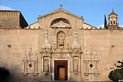 View from the front of the baroque main entrance to the church, 16th century, of the Monestir de Poblet, 1151, Vimbodi, Catalonia, Spain, pictured on May 20, 2006, in the evening. The Monastery of Poblet belongs to the Cistercian Order and was founded by French monks. Originally, Cistercian architecture, like the rules of the order, was frugal. But continuous additions  including late Gothic and Baroque, eventually made Poblet one of the largest monasteries in Spain which was later used as a fortress and royal palace. The steeple on the right is of the sacristy. It was closed in 1835 by the Spanish State but refounded in 1940 by Italian Cistercians. It is a UNESCO World Heritage Site. Picture by Manuel Cohen.