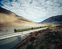 High Speed Train Traveling Through Valley