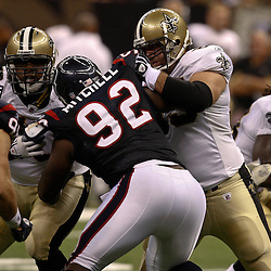 August 21, 2010; New Orleans, LA, USA; New Orleans Saints center Matt Tennant (65) and offensive tackle Na'Shan Goddard (70) block against Houston Texans defensive tackle Earl Mitchell (92) and defensive end Connor Barwin (98) during the second half of a 38-20 win by the New Orleans Saints over the Houston Texans during a preseason game at the Louisiana Superdome. Mandatory Credit: Derick E. Hingle