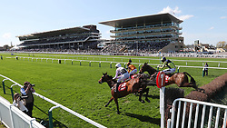Traffic Fluide ridden by Joshua Moore on their way to victory  in the Barchester Healthcare Silver Trophy Chase during the April Meeting at Cheltenham Racecourse