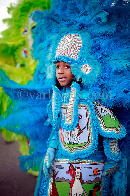 29 August 2014. Lower 9th Ward, New Orleans, Louisiana. <br /> Survivors of the storm. Mardi Gras Indian Michael 'Spy Boy' Tenner (10 yrs) of the Comanche Hunters leads a touching second line parade along Tennessee Street in the Lower 9th Ward in memory of those who perished in the storm 9 years ago. <br /> Photo; Charlie Varley/varleypix.com