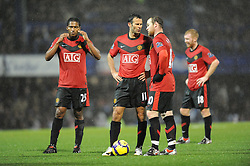Ryan Giggs (centre left-Manchester United) and Wayne Rooney (Manchester United) discuss tactics before a free kick. Portsmouth v Manchester United (1-4), Barclays Premier League Fratton Park, Portsmouth, 28th November 2009.