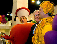 Omaha, Neb 5/6/06 Warren Buffet sings with the Fruit of the Loom fruits at the Berkshire Hathaway annual meeting in the Qwest Center Omaha Saturday Morning..(Chris Machian/For Bloomberg)