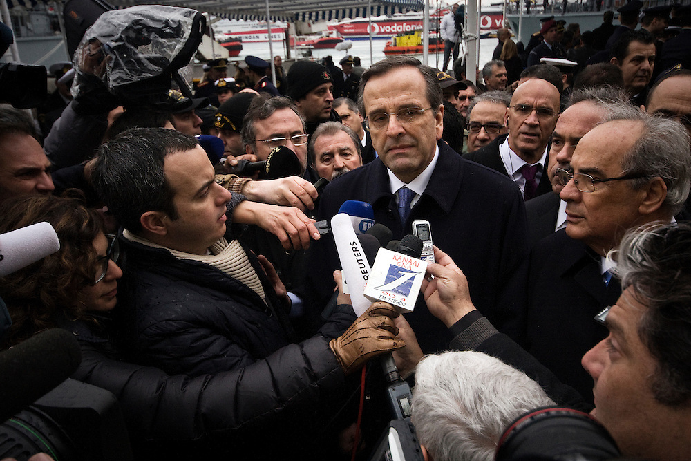 06-01-2013 Athens, Greece - Greek Prime Minister Antonis Samaras talks to the media after the ceremony for the celebration of the Orthodox Epiphany Day in the port of Piraeus.
