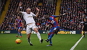 Pape Souare playing the ball past the challenging Jonjo Shelvey during the Barclays Premier League match between Crystal Palace and Swansea City at Selhurst Park, London, England on 28 December 2015. Photo by Michael Hulf.