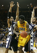 24 JANUARY 2007: Iowa forward Tyler Smith (34) is guarded by Penn State guard David Jackson (32) and forward Jamelle Cornley (2) in Iowa's 79-63 win over Penn State at Carver-Hawkeye Arena in Iowa City, Iowa on January 24, 2007.