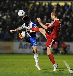 Bristol Rovers' Matty Taylor gets a boot to head from Aldershot Town's Sam Hatton - Photo mandatory by-line: Neil Brookman/JMP - Mobile: 07966 386802 - 20/03/2015 - SPORT - Football - England - Memorial Stadium - Bristol Rovers v Aldershot - Vanarama Football Conference