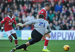 Bristol City's Aaron Wilbraham rounds Preston North End's Thorsten Stuckmann but his effort goes over  - Photo mandatory by-line: Joe Meredith/JMP - Mobile: 07966 386802 - 22/11/2014 - Sport - Football - Bristol - Ashton Gate - Bristol City v Preston North End - Sky Bet League One