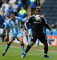 Photo: Steve Bond/Richard Lane Photography.<br />Coventry City v Chelsea. FA Cup 6th Round. 07/03/2009. Didier Drogba (R) shields the ball from Marcus Hall