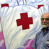 Stanley C. Feist Ph.D. a mental health conselor is seen here at the West Palm Beach Red Cross Tuesday, April. 23. 2002.  Stanley is a volunteer member of the Red Cross Disaster Action Team and is their speaker's bureau. (Freelance photo/ Steve Mitchell)