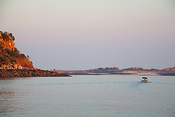 Environmentalist and photographer Richard Costin sets off at first light for Wailgwin Island, in Camden Sound on the Kimberley coast of Western Australia.