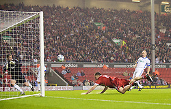 LIVERPOOL, ENGLAND - Thursday, May 14, 2009: Liverpool Legends' John Aldridge scores a goal past All Star's goalkeeper Bobby Mimms during the Hillsborough Memorial Charity Game at Anfield. (Photo by David Rawcliffe/Propaganda)