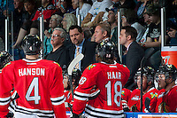 KELOWNA, CANADA - APRIL 25: Karl Taylor, assistant coach, speaks to players during a time out against the Kelowna Rockets on April 25, 2014 during Game 5 of the third round of WHL Playoffs at Prospera Place in Kelowna, British Columbia, Canada. The Portland Winterhawks won 7 - 3 and took the Western Conference Championship for the fourth year in a row earning them a place in the WHL final.  (Photo by Marissa Baecker/Getty Images)  *** Local Caption *** Karl Taylor;