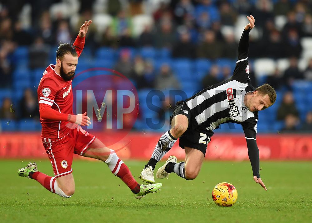Cardiff City's John Brayford tackles Watford's Almen Abdi - Photo mandatory by-line: Paul Knight/JMP - Mobile: 07966 386802 - 28/12/2014 - SPORT - Football - Cardiff - Cardiff City Stadium - Cardiff City v Watford - Sky Bet Championship