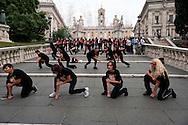 Roma, 11 Ottobre 2012.Asili nido pubblici. Flash mob delle educatrici dei Nidi comunali  dell'USB sulla scalinata del Campidoglio.Il flash mob, ispirato alla danza maori degli all blacks (la squadra di.rugby neozelandese), ha voluto richiamare l'attenzione della citta' sulla.necessita' di investire maggiori risorse nei nidi pubblici di qualita' e nel superamento della precarieta' lavorativa..