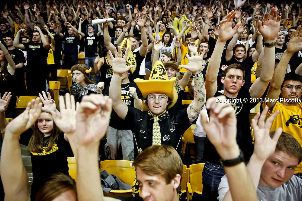 "SHOT 3/7/13 8:08:51 PM - University of Colorado sophomore Billy Cox, 20, of Boulder, Co. takes part in the ""roller coaster"" cheer with other fans during halftime of a game against Oregon at the Coors Events Center on the University of Colorado campus in Boulder, Co. Colorado won the game 76-53. The Colorado student cheering section is knicknamed the ""C-Unit""..(Photo by Marc Piscotty / © 2013)"