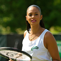 LONDON, ENGLAND - JUNE 22:  Alesha Dixon challenges the queing public to a game of tennis on the Robinson Mini Court at Wimbledon on June 22, 2009 in London, England.  Tim Henman has been training Alesha in the lead up  (Photo by Marco Secchi/Getty Images)