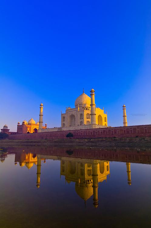 The Taj Mahal reflecting into the Yamuna River in the foreground, Agra, Uttar Pradesh, India