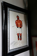 Monday, July 8, 2013 REGGIE WILLIAMS : For former Cincinnati Bengals player and Cincinnati City Councilman Reggie Williams this photo of Muhammad Ali symbolizes the pain he goes through and makes it worth while when he leaves his home in Orlando. The Enquirer/Jeff Swinger