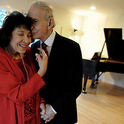97 year-old Raymond Suchy kisses his wife 87 year-old Gregoria Karides-Suchy on the cheek in front of her piano as they celebrate their 63rd Wedding Anniversary on Tuesday, December 28, 2010 in Pasadena.
