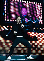 "© Licensed to London News Pictures. 29/03/2013. London, UK.   Olly Murs performing live at O2 Arena. Oliver Stanley ""Olly"" Murs is an English singer-songwriter, musician and television presenter. Murs rose to fame after finishing as the runner-up in the sixth series of The X Factor in 2009. Photo credit : Richard Isaac/LNP"