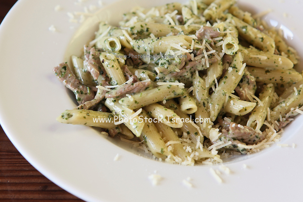A serving of Penne pasta with herbs, beef and cheese