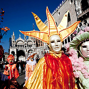 Masked revellers stroll in Saint Mark Square during the 2010 Venetian Carnival in Venice.