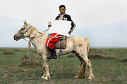 Ba Te Er - 18 Yrs.<br /> Was a Mongolian herder but due to a ban on keeping lifestock in the area is now a tourist guide.<br /> Inner Mongolia.<br /> <br /> (Illiterate) 'Without my horse I am nothing'.