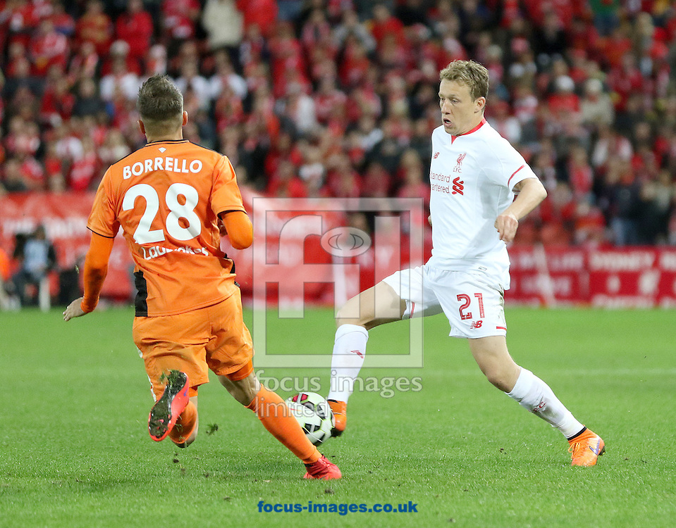 Brandon Borrello of Brisbane Roar and Lucas Leiva of Liverpool during the pre season friendly match at Suncorp Stadium, Brisbane<br /> Picture by Steven Gibson/Focus Images Ltd +61 413 768835<br /> 17/07/2015