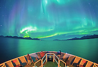 Aurora Borealis or Northern Lights above the bow of a ship in Chatham Strait in Southeast Alaska.