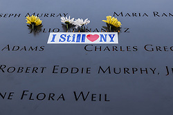 September 11, 2016 - New, York, New York, U.S. - Flowers adorn the names of the fallen victims of the September 11, 2001 terrorist attacks during the formal ceremony at Ground Zero to commemorate the 15th anniversary of the attacks on the World Trade Center. (Credit Image: © Albin Lohr-Jones/Pacific Press via ZUMA Wire)