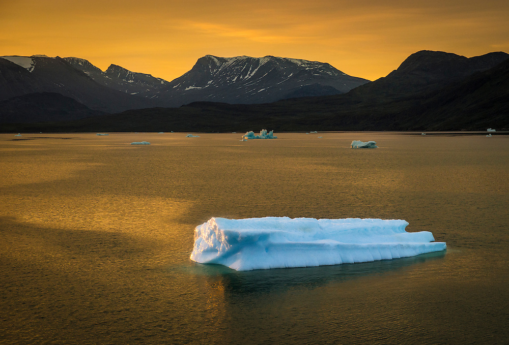 A blue iceberg floating off the shore of Greenland.