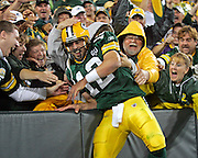 Aaron Rodgers enjoys his first Lambeau leap of the season after his sneak for a touchdown in the second half of their NFL game at Lambeau Field in Green Bay, Wi., Monday, Sept, 8, 2008. Jeffrey Phelps/jphelps@journalsentinel.com