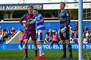 Swansea City forward Oliver McBurnie (9), Queens Park Rangers defender Angel Rangel (22) and Queens Park Rangers goalkeeper Joe Lumley (13) during the EFL Sky Bet Championship match between Queens Park Rangers and Swansea City at the Loftus Road Stadium, London, England on 13 April 2019.