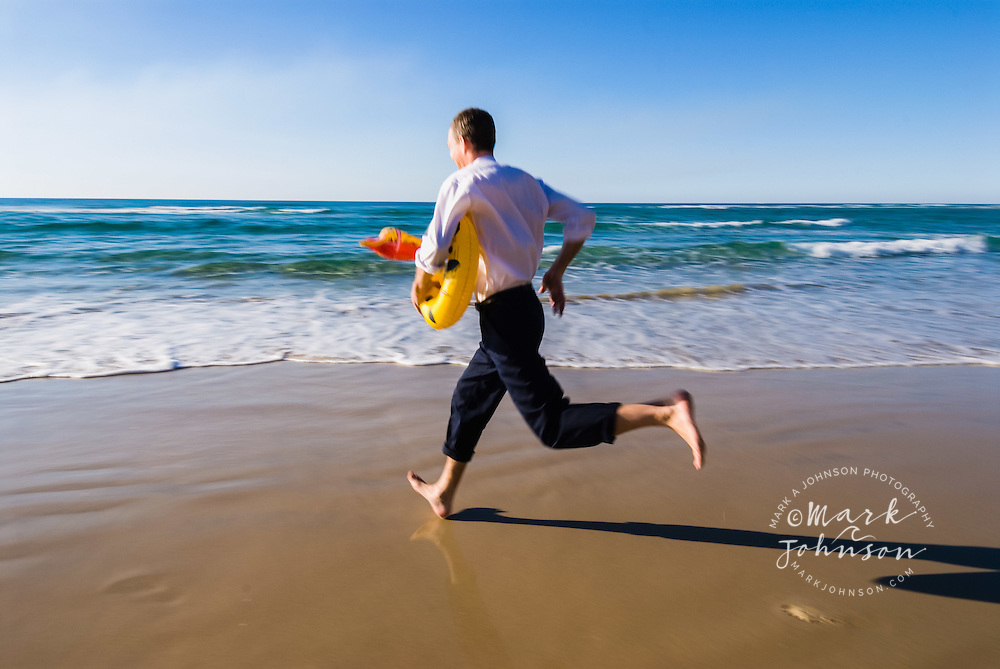 Businessman Running on Beach