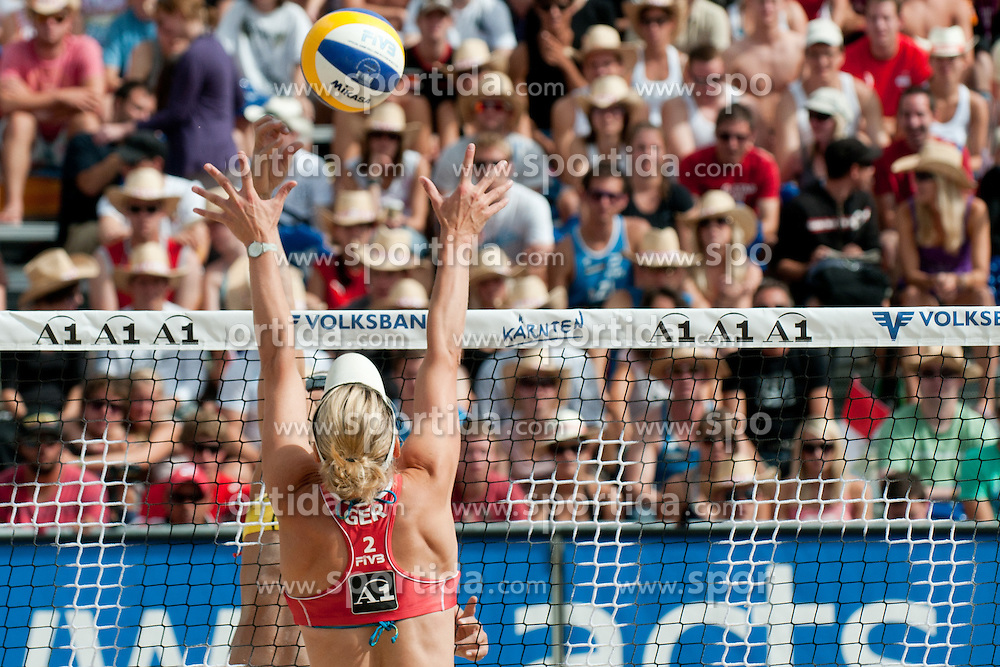 Sara Goller of Germany tries to block the shot at A1 Beach Volleyball Grand Slam tournament of Swatch FIVB World Tour 2010, semifinal, on July 31, 2010 in Klagenfurt, Austria. (Photo by Matic Klansek Velej / Sportida)
