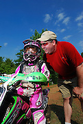 Father encourages daughter at OCCRA race near Guthrie, Oklahoma