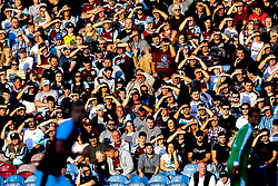 Burnley fans shield their eyes from the sun as they watch their team take on Aberdeen - Mandatory by-line: Robbie Stephenson/JMP - 02/08/2018 - FOOTBALL - Turf Moor - Burnley, England - Burnley v Aberdeen - UEFA Europa League Second Qualifier, 2nd Leg