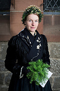 Annegret, member of the 'Hessische Vereinigung f&uuml;r Tanz- und Trachtenpflege Fachgruppe Brauchtum und Trachten' is wearing an original traditional bridal costume from the Sch&ouml;nsteiner Amtstracht in Marburg, Hesse, Germany on November12, 2016.<br /> <br /> This evangelical traditional costume is from around 1920. Marburg is one of the few areas in Germany where women still wear a traditional costume (around 80 nowadays).<br /> Only pristine women were allowed to wear the bridal crown.<br /> <br /> This is part of the series about Traditional Wedding Gowns from different regions of Germany, worn by young members of local dance groups and cultural associations that exist to preserve and celebrate the cultural heritage. The portraiture series is a depiction of an old era with different social values and religious beliefs in an antiquated civil society with very few of those dresses left.