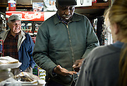 Ervin Pettaway stops by Buchanan's Store in Mason, NC. (owner Wilson Fleming in the background)