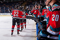 KELOWNA, CANADA - NOVEMBER 29: Braydyn Chizen #22, Gordie Ballhorn #4, Liam Kindree #26 and Dillon Dube #19 of the Kelowna Rockets skate to the bench to celebrate a goal against the Prince George Cougars on November 29, 2017 at Prospera Place in Kelowna, British Columbia, Canada.  (Photo by Marissa Baecker/Shoot the Breeze)  *** Local Caption ***